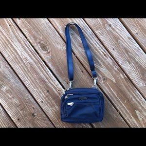 BAGGALLINI blue time zone RFID crossbody bag